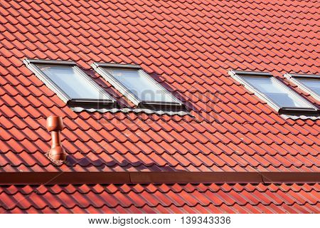 New red metal roof with skylights and Ventilation pipe for heat control