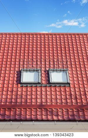 Red Metal tiled Roof with New Dormers, Roof Windows, Skylights and Roof Protection from Snow Board