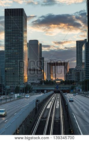 Skyscrapers With Glass Facade And Grande Arch. Modern Buildings In Paris Business District. Concepts