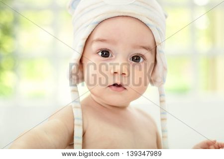 Beautiful baby face with coif close up poster