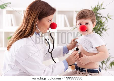 Doctor Pediatrician And Patient Happy Child