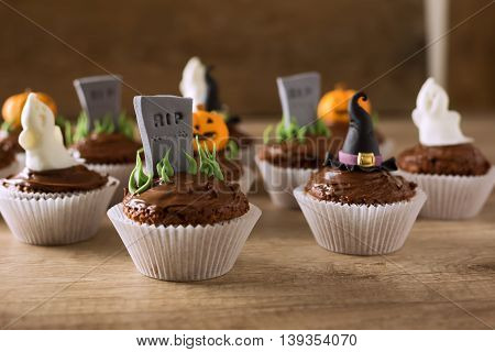 Group Of Helloween Cupcakes On Wood Table