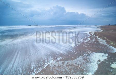 long exposure shot of North sea coast Holland