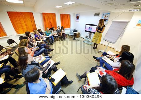 MOSCOW - MAR 26, 2015: Stylist Ekaterina Panyutischeva (with model release) and students at Disclosure of feminine style master class