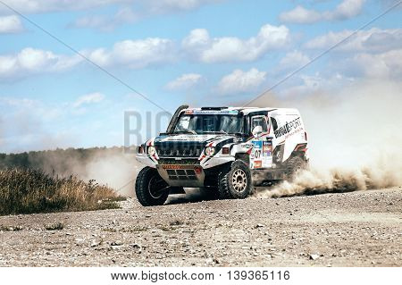 Filimonovo Russia - July 11 2016: rally car driving on dusty road during Silk way rally