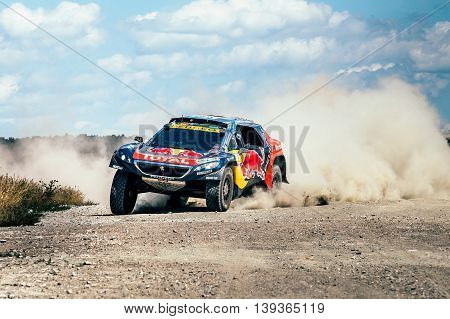 Filimonovo Russia - July 11 2016: racing car Peugeot driving on a dusty road during Silk way rally