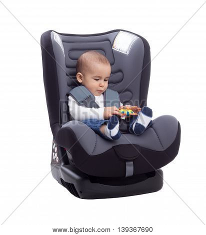 Baby Child In Car Seat Playing With Toy