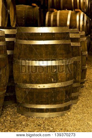 One Wine barrel stacked in the old cellar of the winery.