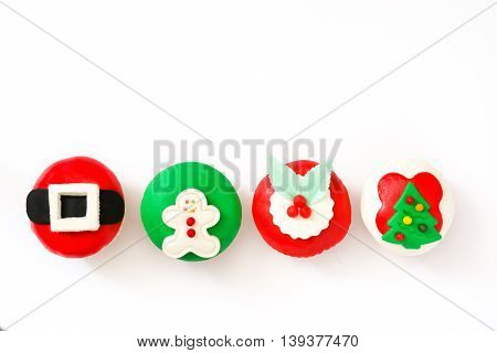Sweet christmas cupcakes isolated on white background