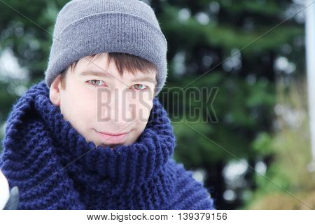 Smilling Man with scarf and woolly hat in the winter