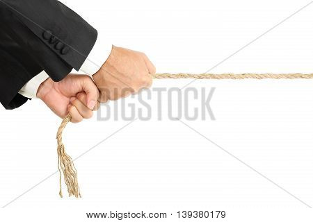 businessman pulling a rope isolated on white