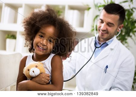 Beautiful Smiling Afro-american Girl With Her Pediatrician