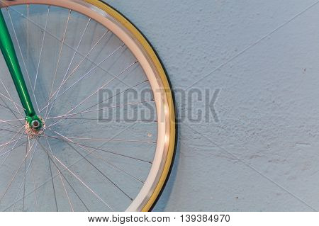 Bicycle Wheel And Spokes Detail Closeup. Image With Hub And Spokes Of Green And Shiny Golden Bicycle