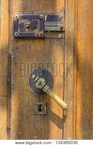 Vertical View With Old Doors Closeup. Old Doorknob At Wood Front Door Isolated On White Background..