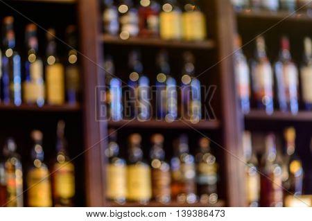 Blurred Of Wine Bottles. Blurred Image Of Bottles Of Wine On The Shelves In Market..
