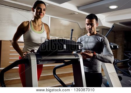 Personal Trainer Exercise With His Client