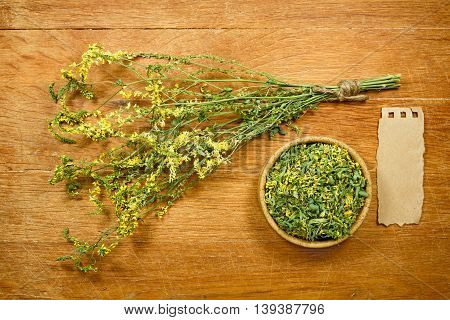 Melilot.Dried herbs for use in alternative medicine.Herbal medicine phytotherapy medicinal herbs.For preparation of infusions decoctions tinctures powders ointments tea.Background green cloth