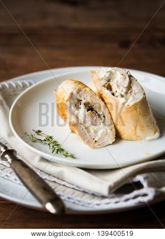 Chicken roulade with cream cheese and porcini filling