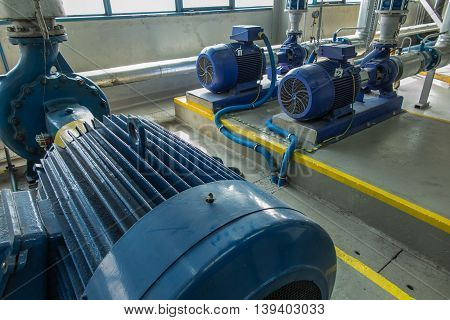 the several water pumps with large electric motors