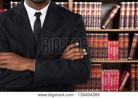 Close-up Of A Male Lawyer With Arms Crossed In Office