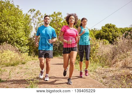 Three Joggers On A Leisurely Run