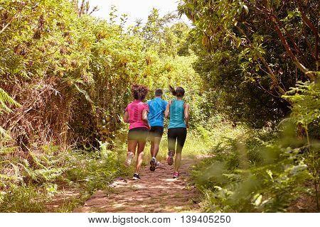 Three Friends Running Away From Camera