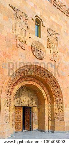 YEREVAN ARMENIA - MAY 29 2016: The facade of St Sarkis Cathedral decorated with the complex carved ornaments on May 29 in Yerevan.
