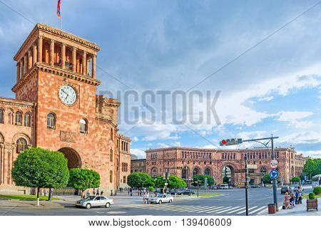 YEREVAN ARMENIA - MAY 29 2016: The walk along the Republic Square with its scenic red buildings of local tuff on May 29 in Yerevan.