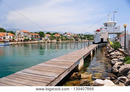 SUCURAJ, HVAR ISLAND, CROATIA - June 26, 2016: Ferry from Drvenik just arrived at Sucuraj. The port is an important base for trade and popular touristic destination