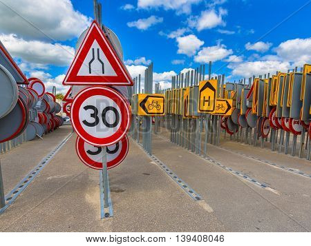 Bottleneck Road Narrowing Speed Limit Sign