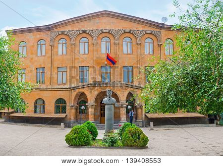 YEREVAN ARMENIA - MAY 29 2016: The facade of Anton Chekhov Basic School with the monument to this famous Russian writer in front of it on May 29 in Yerevan.