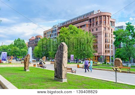 YEREVAN ARMENIA - MAY 29 2016: The open air exhibition named The Cultural Genocide: symbol of Khachkars shows the copies of destroyed or lost medieval cross-stones on May 29 in Yerevan.