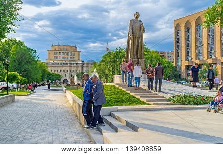 YEREVAN ARMENIA - MAY 29 2016: The newly opened Garegin Nzhdeh monument with the National Gallery on the background on May 29 in Yerevan.