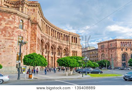 YEREVAN ARMENIA - MAY 29 2016: The buildings of the city boasts unusual and bright colors they covered with local travertine and tuff on May 29 in Yerevan.