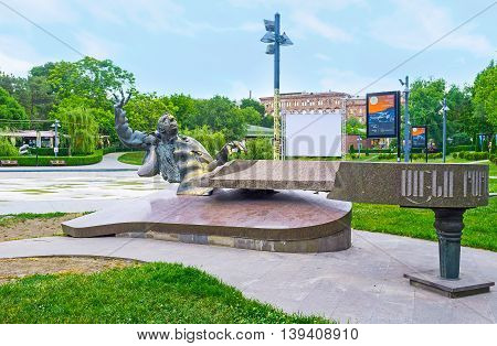 YEREVAN ARMENIA - MAY 29 2016: The monument to Arno Babajanian Armenian composer and pianist passionately playing the piano on May 29 in Yerevan.