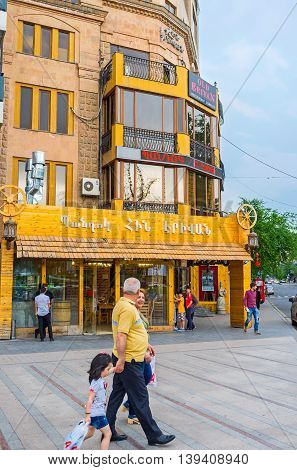 YEREVAN ARMENIA - MAY 29 2016: People enjoy the walk along the tourist street with many cafes and restaurants on May 29 in Yerevan.