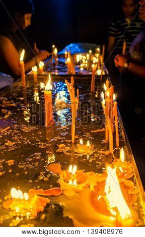 YEREVAN ARMENIA - MAY 29 2016: The people pray and light the candles in the dark chapel of St Sarkis Cathedral on May 29 in Yerevan.