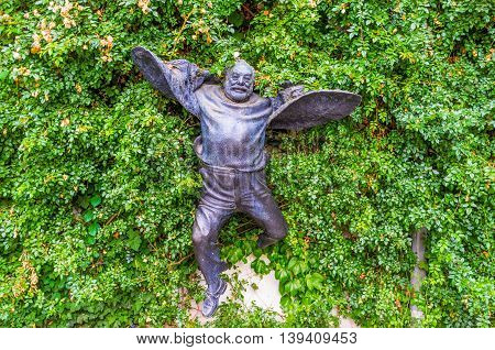 TBILISI GEORGIA - MAY 28 2016: The unusual flying statue of Sergei Parajanov famous avant garde filmmaker and artist on May 28 in Tbilisi.