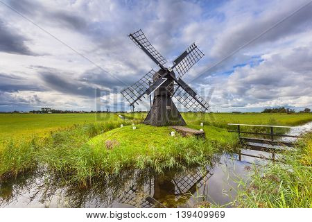 Historic Wooden Windmill From The Netherlands