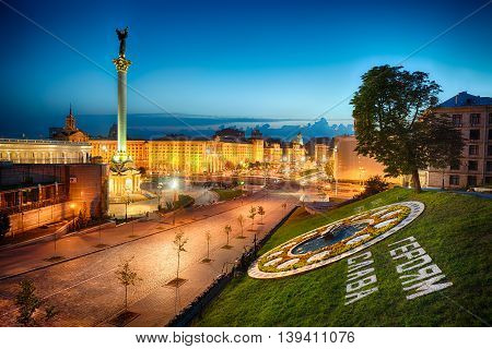 Night view of the Maidan Nezalezhnosti Institutskaya and Khreshchatyk street in Kyiv. Independence square in capital of Ukraine - Kiev