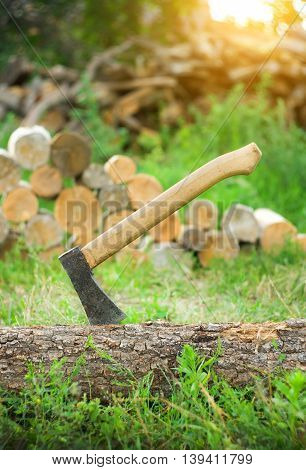 Axe in a log closeup.Ready for cutting timber