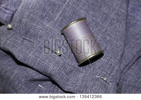The second step in the process of hemming a pair of slacks.