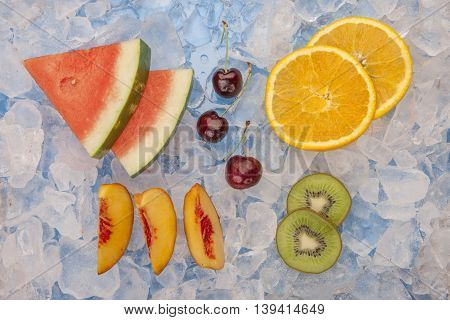 Chilled fruit slices and wedges. An assortment of fruit slices and wedges on ice.