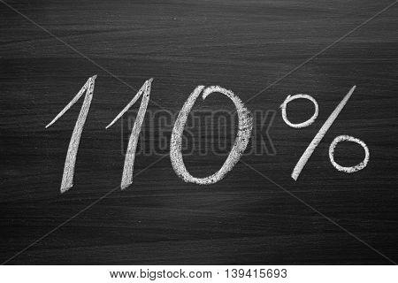 110 percent header written with a chalk on the blackboard