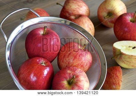 A sieve full of Royal Gala Apples