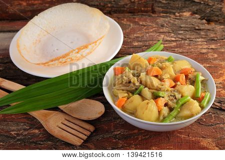 South Indian cuisine Appam with mutton stew,