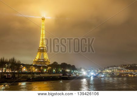 Paris France, 3 December 2014:  Eiffel Tower is a wrought iron lattice tower on the Champ de Mars in Paris, France. It is named after the engineer Gustave Eiffel, whose company designed and built the tower.