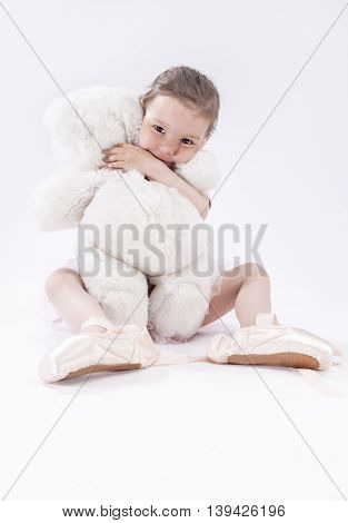 Portrait of Cute Caucasian Female Kid Sitting Together with Plush Toy and Smiling.Vertical Image Composition poster