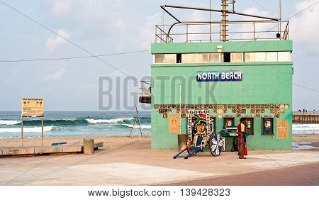 DURBAN SOUTH AFRICA - AUGUST 17 2015: Rikshaw at the North Beach lifesaver's station on The Golden Mile promenade