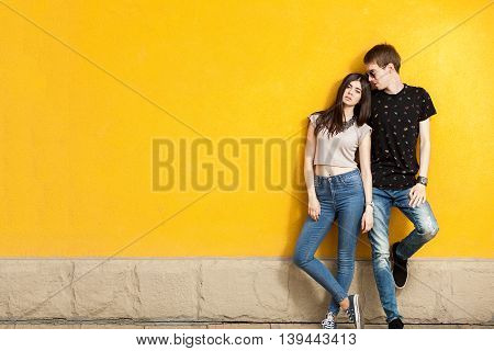 Younf Woman And Men Posing In Fashion Jeans Style